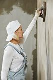 Plasterer at indoor wall work Stock Image