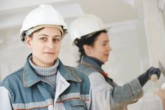 Plasterer at indoor wall work Stock Photography