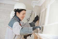 Plasterer at indoor wall work Stock Photos
