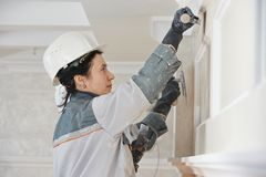 Plasterer at indoor wall work Royalty Free Stock Photos
