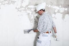 Free Plasterer Man At Work With Trowel Plastering The Wall Of Interior Construction Site Wear Helmet And Protective Gloves,  Royalty Free Stock Image - 175852026