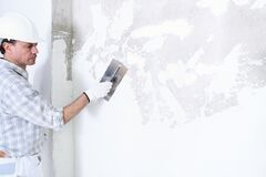 Free Plasterer Man At Work With Trowel Plastering The Wall Of Interior Construction Site Wear Helmet And Protective Gloves, Isolated Stock Photography - 175848602