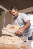 Plasterer Mixing Plaster. In Building Renovation Royalty Free Stock Photos