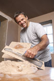 Plasterer Mixing Plaster. In Building Renovation Stock Photos
