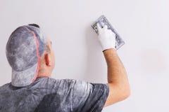Plasterer polishing a gypsum wall Royalty Free Stock Image