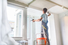 Plasterer renovating indoor walls and ceilings. Stock Photography