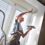 Plasterer renovating indoor walls and ceilings. Stock Images