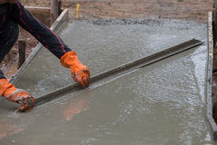 Plasterer screed concrete for floor Royalty Free Stock Image