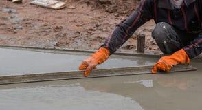 Plasterer screed concrete for floor Stock Photos