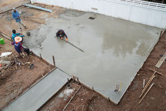 Plasterer screed concrete for floor Royalty Free Stock Photography