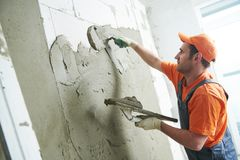 Plasterer putting plaster on wall. slow motion royalty free stock images
