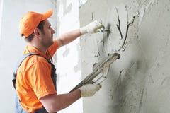 Plasterer putting plaster on wall. slow motion stock image