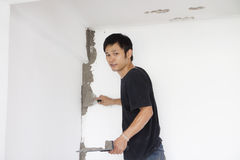 Plasterer at wall renovation decoration Stock Photography