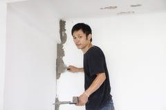 Plasterer at wall renovation decoration Stock Photography