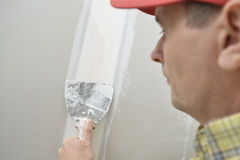 Plasterer wearing red hat Stock Photo