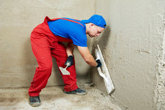 Plasterer at work. Plasterer at indoor wall renovation decoration with float Royalty Free Stock Photos
