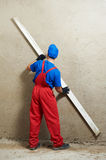 Plasterer at work. Plasterer at indoor wall renovation decoration with sleeker Royalty Free Stock Images