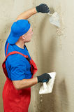 Plasterer at work. Plasterer at indoor wall renovation decoration with float Stock Photography