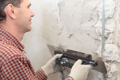 Plasterer at work Stock Photography
