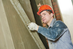 Plasterer at work with wall Stock Photography
