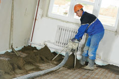 Plasterer worker at cement floor construction work Stock Photography