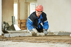 Plasterer worker at floor work Royalty Free Stock Photos