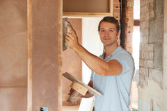 Plasterer Working On Wall Royalty Free Stock Photos