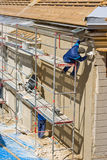 Plasterers. At work on a scaffold Royalty Free Stock Photography