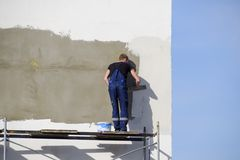 Plasterers Builders plastered wall in a commercial building. Wor Royalty Free Stock Image