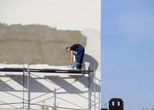 Plasterers Builders plastered wall in a commercial building. Wor Stock Photo