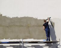 Plasterers Builders plastered wall in a commercial building. Wor Royalty Free Stock Photos