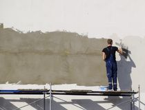Plasterers Builders plastered wall in a commercial building. Wor Stock Photos