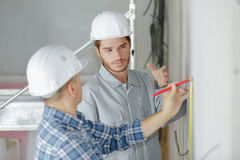 Plasterers sealing joint building wall Royalty Free Stock Image