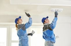 Plastererst at indoor ceiling work Royalty Free Stock Photo