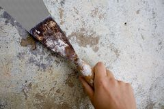 Plastering. Hand plastering a wall Stock Photos