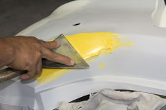 Plastering body car before painting body Royalty Free Stock Image