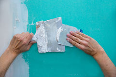 Plastering man hands with plaste on drywall plasterboard. Hydrophobic construction Royalty Free Stock Photography