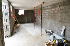 Plastering, rebuilding, waterproofing basement or a cellar and w. Ork tools. Construction of residential house cellar or basement with electric installations and Royalty Free Stock Photos