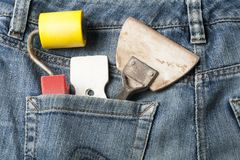 Plastering tools in pocket of jeans.Top view. Stock Photos
