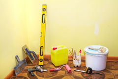 Plastering tools in the yellow room Royalty Free Stock Photos