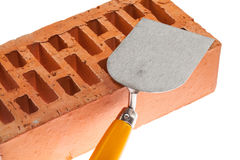 Plastering trowel and a brick Royalty Free Stock Images