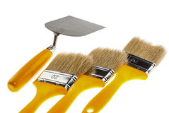 Plastering trowel and paintbrushes Royalty Free Stock Photography