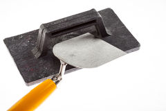 Plastering trowel and surfacer Stock Photography