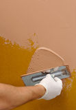 Plastering using a trowel Royalty Free Stock Images