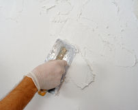 Plastering using a trowel Stock Images