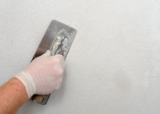 Plastering using a trowel Stock Image