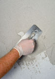 Plastering using a trowel Royalty Free Stock Photography