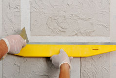 Plastering using a trowel Royalty Free Stock Image