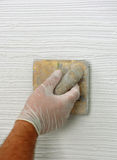 Plastering using a trowel Stock Photo