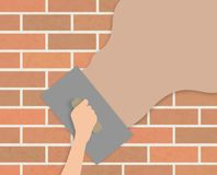 Plastering wall. Illustration of a hand holding a trowel plastering over a wall Stock Photos